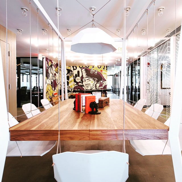 Have you seen the swinging chairs conference table in our building? If not, maybe you should schedule a meeting with us
