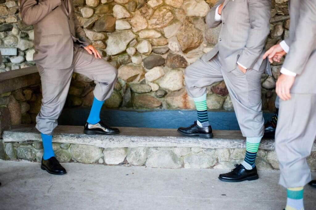 Groom and Groomsmen in gray suits with brightly colored socks