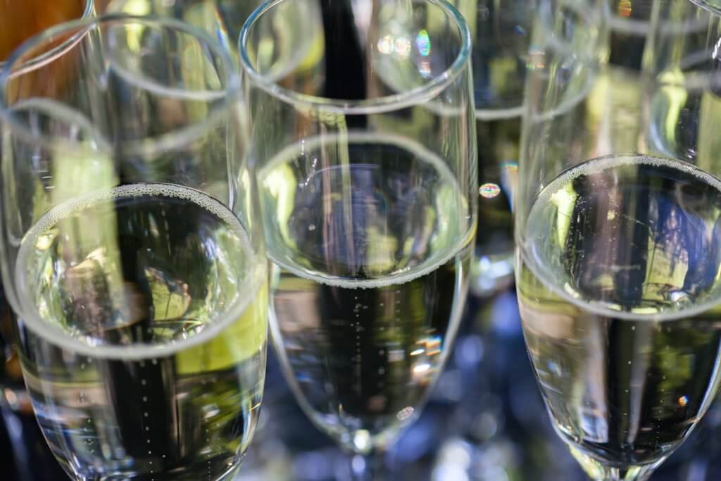 Cluster of champagne-filled flutes
