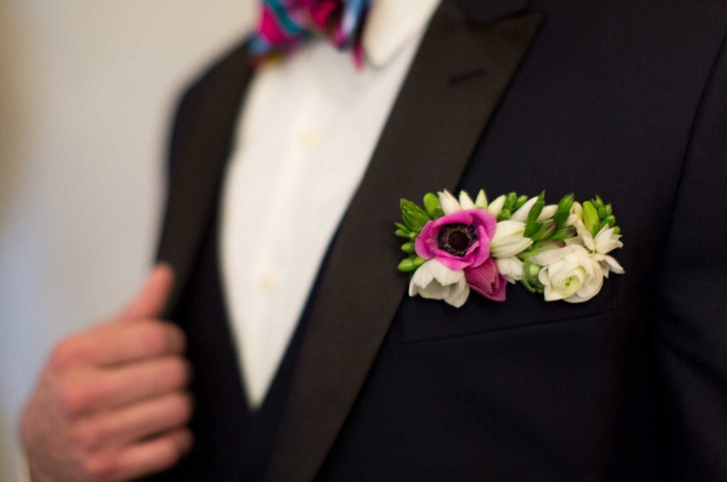 Pocket square made of pink and white flowers